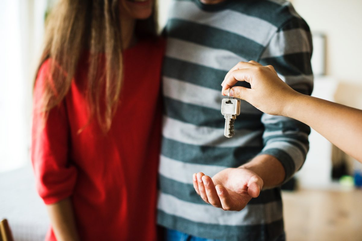 couple getting keys to home